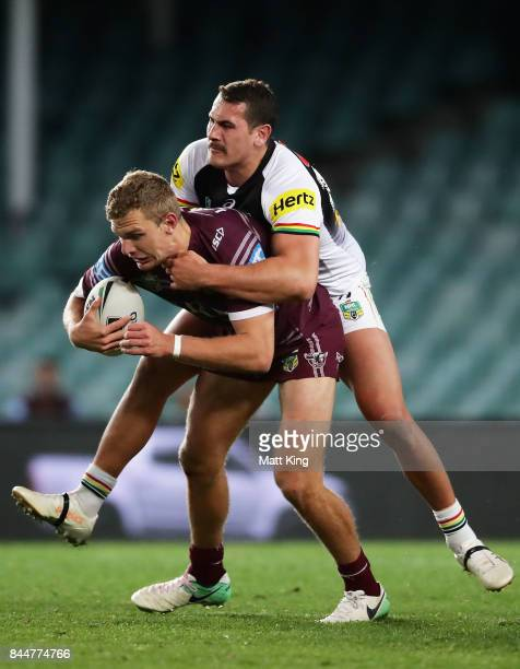 Tom Trbojevic of the Sea Eagles is tackled by Reagan CampbellGillard of the Panthers during the NRL Elimination Final match between the Manly Sea...