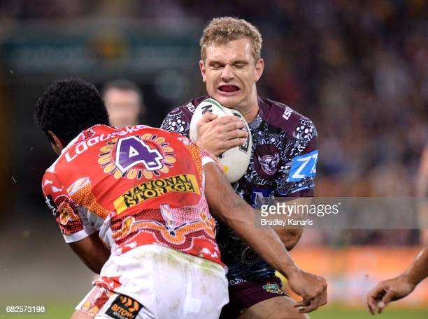 Tom Trbojevic of the Sea Eagles is tackled by Tautau Moga of the Broncos during the round 10 NRL match between the Manly Sea Eagles and the Brisbane...