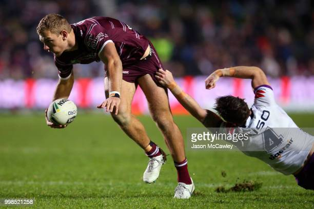 Tom Trbojevic of the Sea Eagles is tackled during the round 18 NRL match between the Manly Sea Eagles and the Melbourne Storm at Lottoland on July 14...