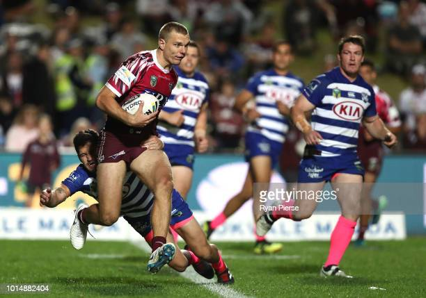 Tom Trbojevic of the Sea Eagles is tackled during the round 22 NRL match between the Manly Sea Eagles and the Canterbury Bulldogs at Lottoland on...