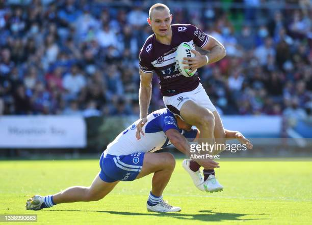 Tom Trbojevic of the Sea Eagles is tackled during the round 24 NRL match between the Manly Sea Eagles and the Canterbury Bulldogs at Moreton Daily...