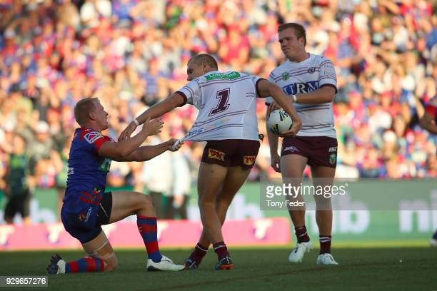 Tom Trbojevic of the Sea Eagles is tackled during the round one NRL match between the Newcastle Knights and the Manly Sea Eagles at McDonald Jones...