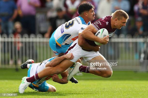 Tom Trbojevic of the Sea Eagles is tackled during the round six NRL match between the Manly Sea Eagles and the Gold Coast Titans at Glen Willow...