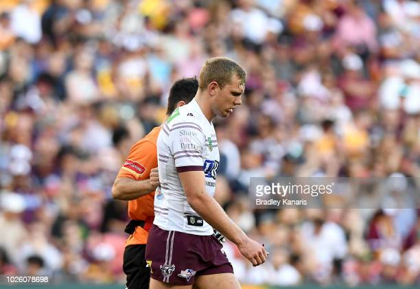 Tom Trbojevic of the Sea Eagles is taken from the field after a head knock during the round 25 NRL match between the Brisbane Broncos and the Manly...