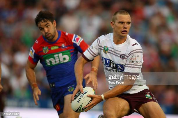 Tom Trbojevic of the Sea Eagles looks to pass during the round one NRL match between the Newcastle Knights and the Manly Sea Eagles at McDonald Jones...