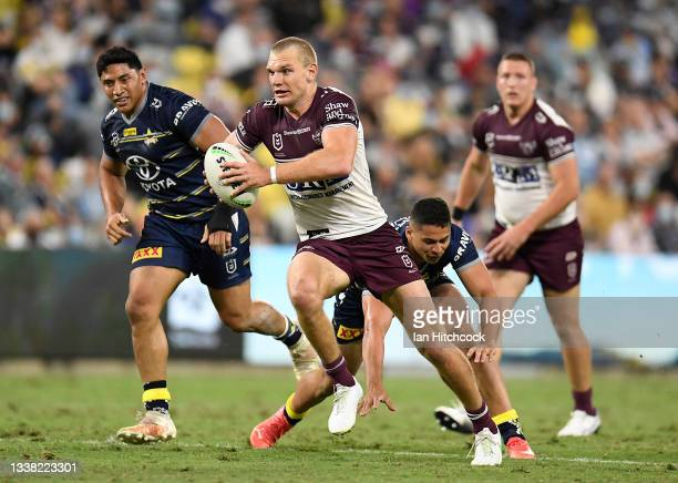 Tom Trbojevic of the Sea Eagles makes a break during the round 25 NRL match between the North Queensland Cowboys and the Manly Sea Eagles at QCB...