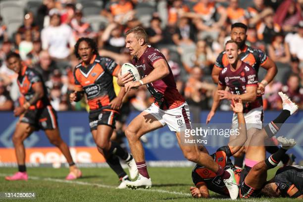 Tom Trbojevic of the Sea Eagles makes a break during the round seven NRL match between the Wests Tigers and the Manly Sea Eagles at Bankwest Stadium,...