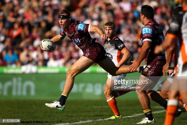 Tom Trbojevic of the Sea Eagles makes a break the round 19 NRL match between the Manly Sea Eagles and the Wests Tigers at Lottoland on July 16 2017...