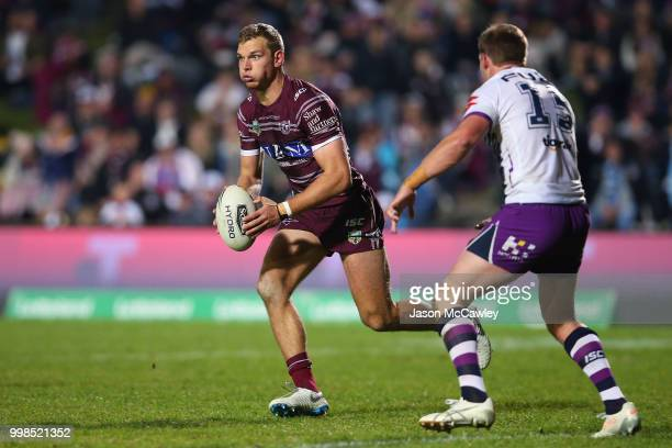 Tom Trbojevic of the Sea Eagles runs the ball during the round 18 NRL match between the Manly Sea Eagles and the Melbourne Storm at Lottoland on July...