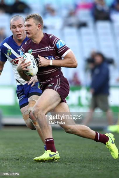 Tom Trbojevic of the Sea Eagles runs the ball during the round 24 NRL match between the Canterbury Bulldogs and the Manly Sea Eagles at ANZ Stadium...