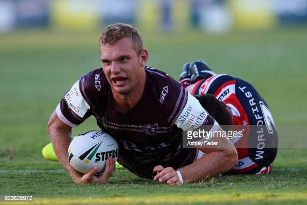 Tom Trbojevic of the Sea Eagles scores a try during the NRL Trial match between the Manly Sea Eagles and the Sydney Roosters at Central Coast Stadium...