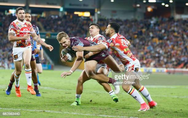Tom Trbojevic of the Sea Eagles scores a try during the round 10 NRL match between the Manly Sea Eagles and the Brisbane Broncos at Suncorp Stadium...