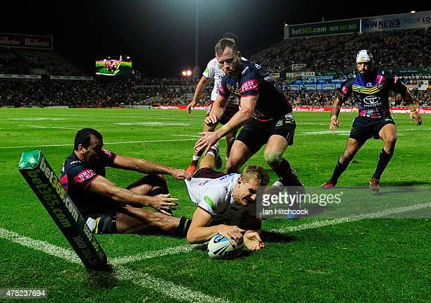 Tom Trbojevic of the Sea Eagles scores a try during the round 12 NRL match between the North Queensland Cowboys and the Manly Sea Eagles at...