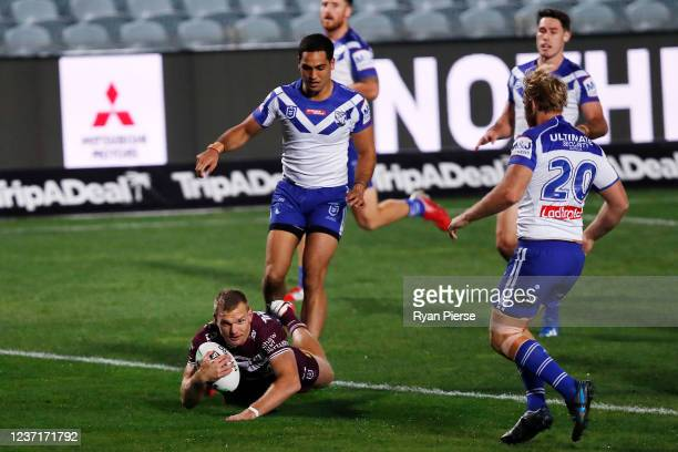 Tom Trbojevic of the Sea Eagles scores a try during the round three NRL match between the Manly Sea Eagles and the Canterbury Bulldogs at Central...