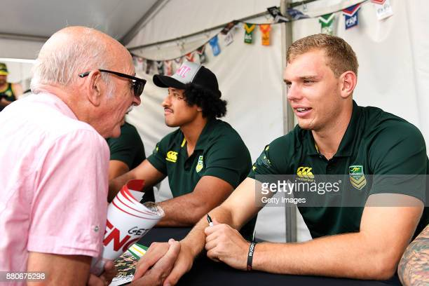 Tom Trbojevic shakes hands with a fan during an Australia Kangaroos and England Signing Session at Reddacliff Place on November 28 2017 in Brisbane...