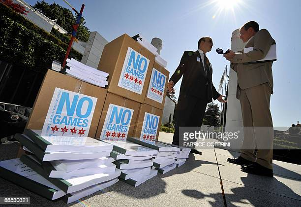 Tom Tresser of the No Games Chicago campaign speaks to a radio reporter during a protest on June 17 2009 during the presentation of the Chicago 2016...