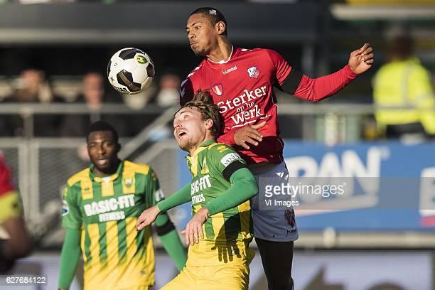 Tom Trybull of ADO Den Haag, Sebastien Haller of FC Utrechtduring the Dutch Eredivisie match between ADO Den Haag and FC Utrecht at Kyocera stadium...