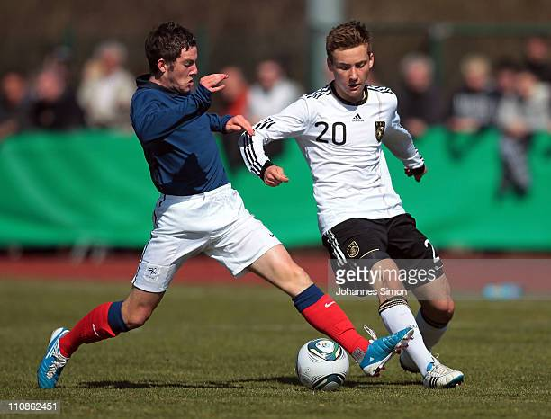 Tom Trybull of Germany and Jordan Veretout of France compete for the ball during the U18 international friendly match between Germany and France at...