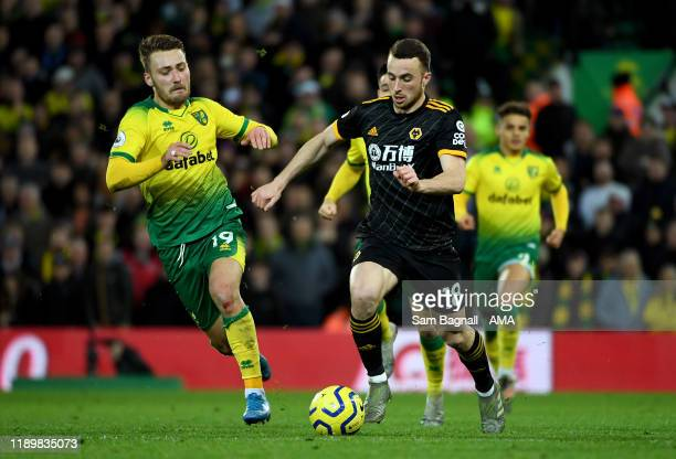 Tom Trybull of Norwich City and Diogo Jota of Wolverhampton Wanderers during the Premier League match between Norwich City and Wolverhampton...