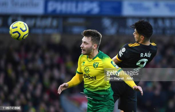Tom Trybull of Norwich City and Raul Jimenez of Wolverhampton Wanderers during the Premier League match between Norwich City and Wolverhampton...