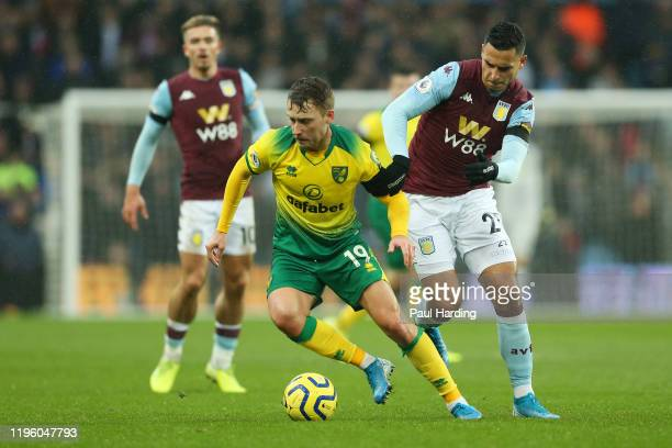 Tom Trybull of Norwich City battles for the ball with Anwar El Ghazi of Aston Villa during the Premier League match between Aston Villa and Norwich...