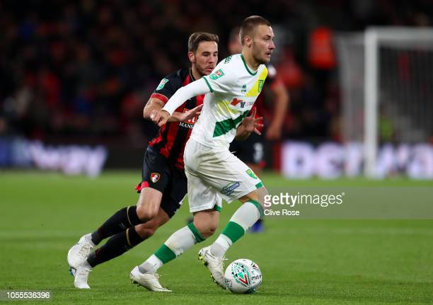 Tom Trybull of Norwich City evades Dan Gosling of AFC Bournemouth during the Carabao Cup Fourth Round match between AFC Bournemouth and Norwich City...