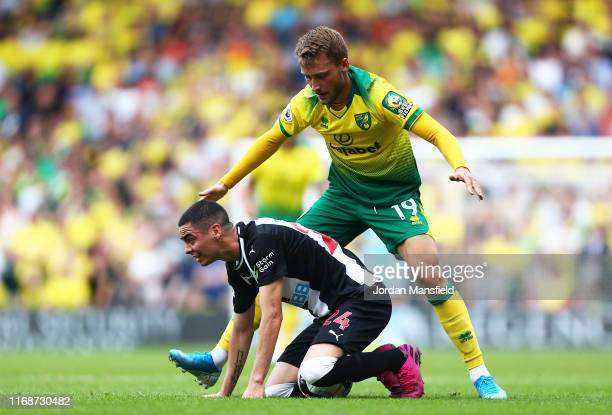 Tom Trybull of Norwich City tackles with Miguel Almiron of Newcastle United during the Premier League match between Norwich City and Newcastle United...