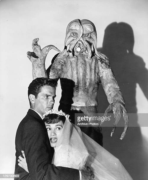 Tom Tryon is grabbed by Gloria Talbott in a scene from the film 'I Married A Monster From Outer Space' 1958