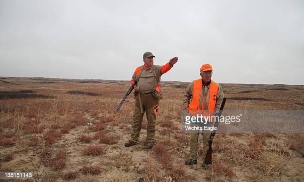 Tom Turner of St John left explains how they'll hunt a huge pasture to Joseph Herzog November 23 in Edwards County Kansas
