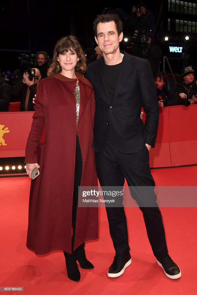 Tom Tykwer (R) and his girlfriend Marie Steinbach attend the closing ceremony during the 68th Berlinale International Film Festival Berlin at Berlinale Palast on February 24, 2018 in Berlin, Germany.