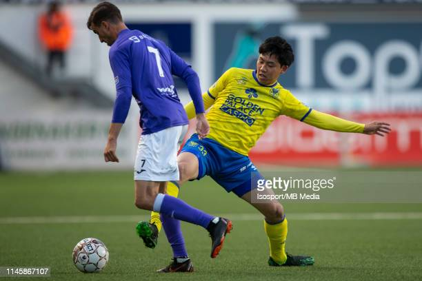 Tom Van Hyfte fight for the ball with Wataru Endo of STVV during the Jupiler Pro League playoff 2 group A match between Stvv and Beerschot Wilrijk on...