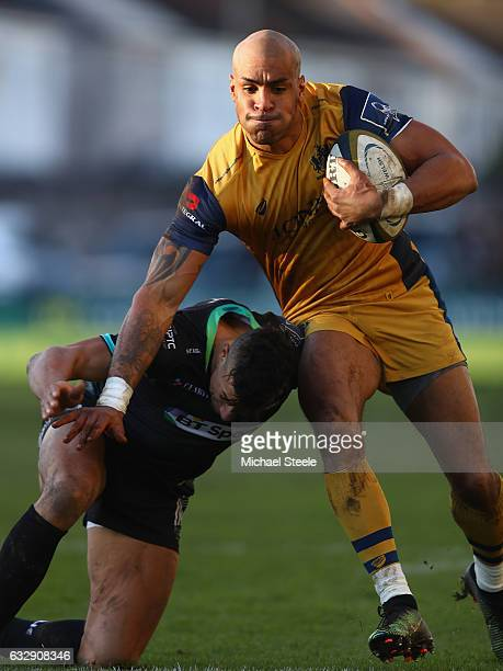 Tom Varndell of Bristol holds off Jay Baker of Ospreys during the Anglo Welsh Cup match between Ospreys and Bristol Rugby at the Brewery Field on...