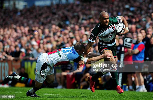 Tom Varndell of Leicester Tigers breaks through the tackle of Mike Brown of Harlequins during the Guinness Premiership match between Leicester Tigers...
