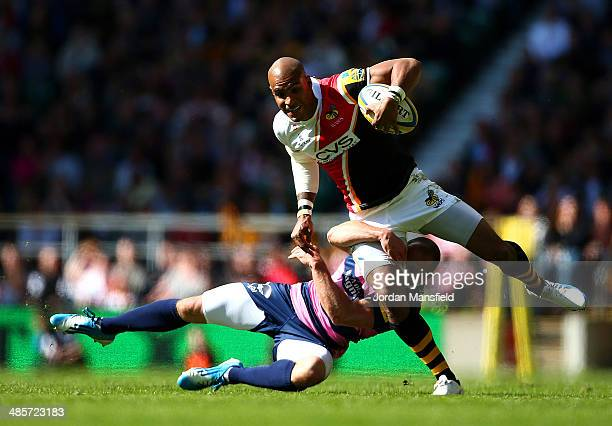 Tom Varndell of London Wasps is tackled by Mike Tindall of Gloucester during the Aviva Premiership match between London Wasps and Gloucester at...