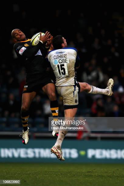 Tom Varndell of Wasps and Jack Cuthbert of Bath compete for the high ball during the London Wasps and Bath LV Anglo Welsh Cup match at Adams Park on...