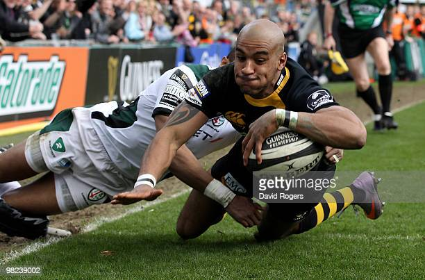 Tom Varndell of Wasps dives over to score a try during the Guinness Premiership match between London Wasps and London Irish at Adams Park on April 4,...