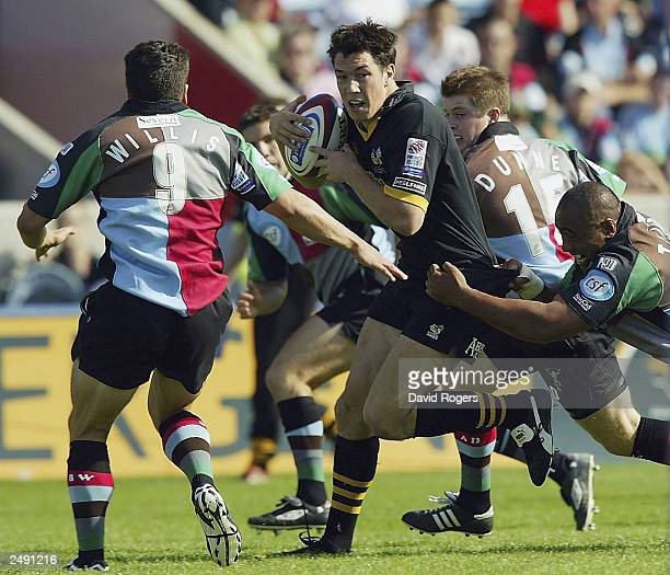 Tom Voyce of Wasps is held back by Tani Fuga of Harlequins during the Zurich Premiership match between Harlequins and Wasps at the Stoop Ground...