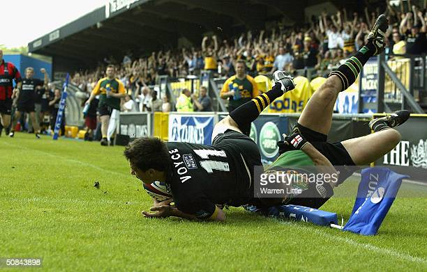 Tom Voyce of Wasps scores the opening try as Ben Cohen of Northampton fails to make the tackle during the Zurich Premiership Semi-Final match between...