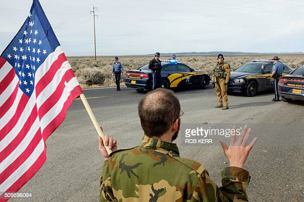 Tom Wagner a selfdescribed supporter of the movement agains the federal government approaches the FBI and Oregon State Police near the Malheur...
