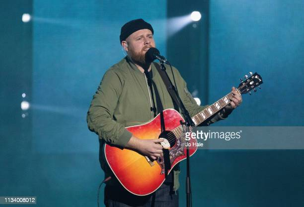 Tom Walker performs on stage at We Day UK at SSE Arena on March 06 2019 in London England