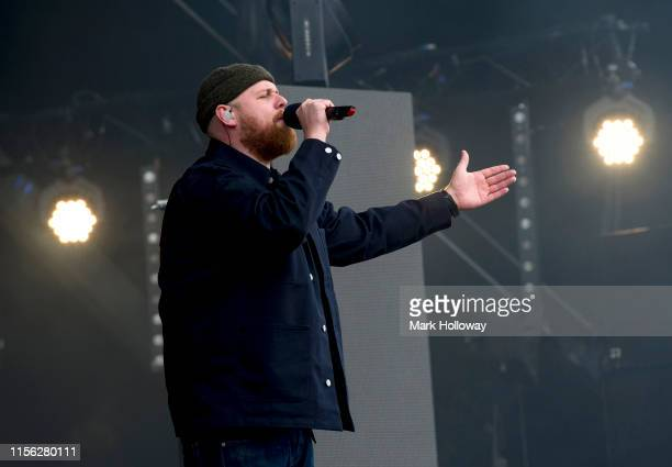Tom Walker performs on stage during Isle of Wight Festival 2019 at Seaclose Park on June 16 2019 in Newport Isle of Wight