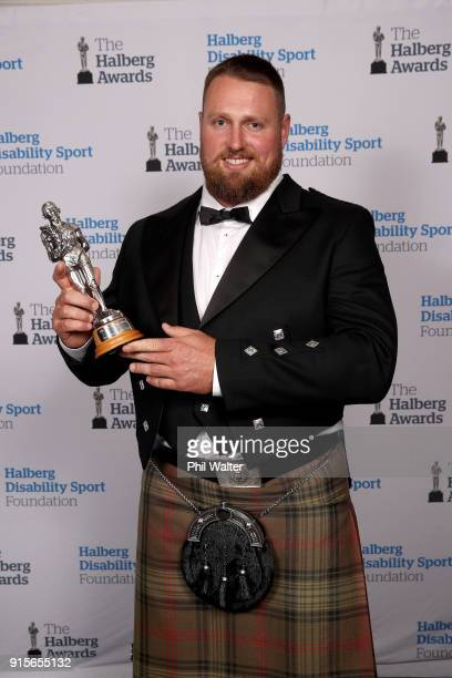 Tom Walsh poses with the Sportsman of the Year award at the 55th Halberg Awards at Spark Arena on February 8 2018 in Auckland New Zealand