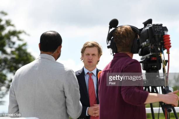 Tom War is interviewed by Richi Persad at Goodwood Racecourse on June 14 2020 in Chichester England Photo by