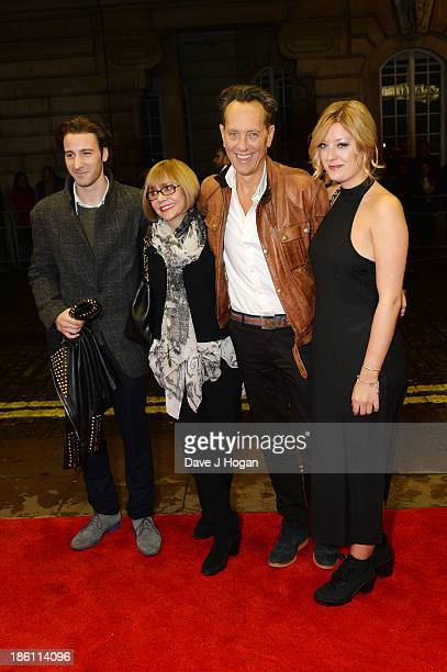 Tom Washington Joan Washington Richard E Grant and Olivia Grant attend the UK premiere of 'Dom Hemingway' at The Curzon Mayfair on October 28 2013 in...