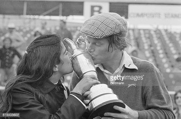 Tom Watson and his wife Linda kiss trophy he has just been awarded 7/13 for winning 18-hole playoff in British Open golf tournament. Watson edged...