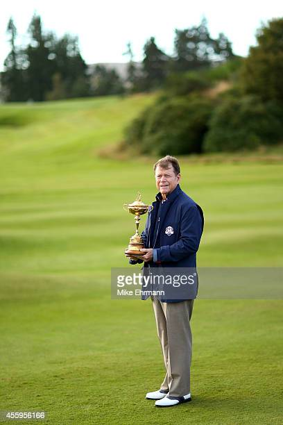 Tom Watson Captain of the United States poses with the Ryder Cup trophy during the USA team photocall ahead of the 2014 Ryder Cup on the PGA...
