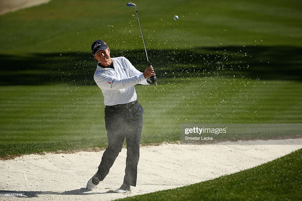 Tom Watson hits a shot out of the bunker on the 15th hole during the first round of the RBC Heritage at Harbour Town Golf Links on April 17, 2014 in Hilton Head Island, South Carolina.