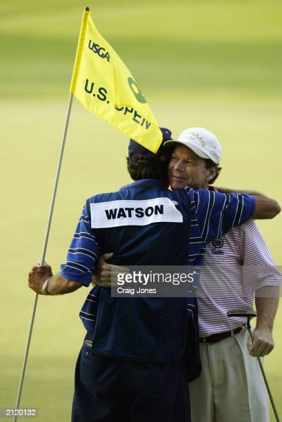 Tom Watson hugs his caddie Bruce Edwards after shooting a 5-under par 65 in the first round of the 2003 US Open on the North Course at the Olympia...