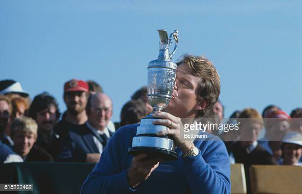 Tom Watson kissing trophy after winning the British Open Golf Tournament.