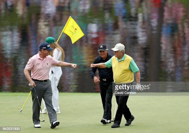 Tom Watson of the United States, Gary Player of South Africa and Jack Nicklaus of the United States show comaraderie during the Par 3 Contest prior...